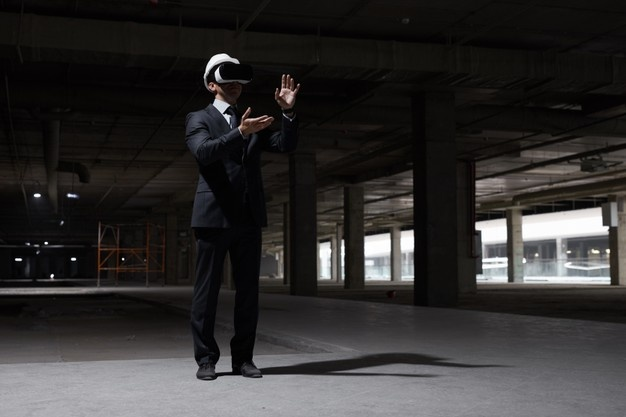 dramatic-full-length-portrait-businessman-wearing-vr-gear-construction-site-while-visualizing-future-project-3d_236854-26145